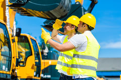 Asian workers on construction site Royalty Free Stock Photos