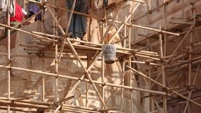 Asian workers working at the construction site stock video