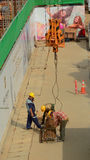 Asian workers working at the construction site Royalty Free Stock Photography