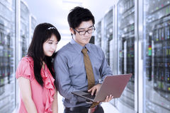 Asian workers working in server room Stock Photography