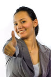 Asian Working Woman Gives Her Thumb Up Royalty Free Stock Images
