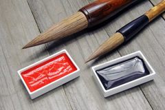 Asian writing brushes and ink for calligraphy stock images
