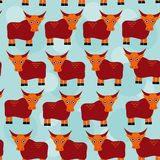 Asian yak bull Seamless pattern with funny cute animal on a blue Stock Photo