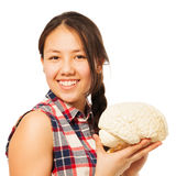 Asian 15 years old girl holding cerebrum model. Cute Asian 15 years old girl holding cerebrum model, isolated on white royalty free stock images