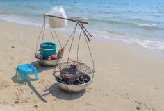Asian yoke with fried seafood on the sand at beach Royalty Free Stock Image