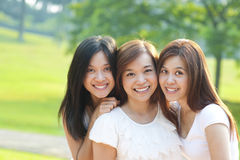 Asian young beautiful friends. On vacation day, outdoor park royalty free stock images