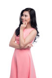 Asian young beautiful woman with long black hair in pink dress s. Tanding over white Stock Photography