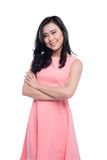 Asian young beautiful woman with long black hair in pink dress s. Tanding over white Royalty Free Stock Photos