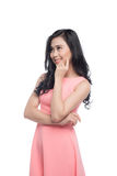 Asian young beautiful woman with long black hair in pink dress s. Tanding over white Royalty Free Stock Photo