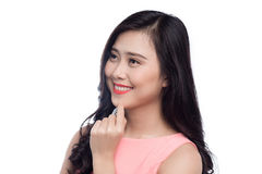 Asian young beautiful woman with long black hair in pink dress s. Tanding over white Royalty Free Stock Image