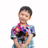 Asian young boy with a bouquet of flowers. On white background Royalty Free Stock Photo