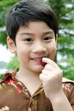 Asian young boy with a cherry Stock Photo