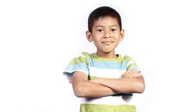 Asian young boy Cross one's arm. Young boy Cross one's arm on white background Stock Photography