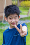 Asian young boy. A cute Asian Thai young boy with thumb-up Stock Photo