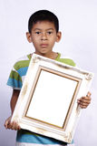 Asian young boy with photo frame Royalty Free Stock Photos