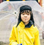 Asian young boy portrait. Asian young boy holding umbrella and going to school Royalty Free Stock Photos