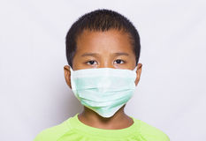 Asian young boy. Wearing disposable face mask Royalty Free Stock Image