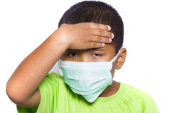 Asian young boy wearing disposable face mask Royalty Free Stock Images