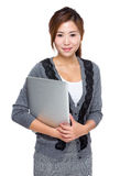 Asian young business assistant with laptop computer Stock Photo