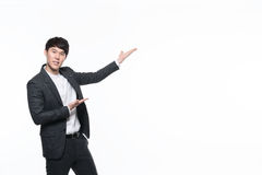 Asian young business man in studio Royalty Free Stock Images