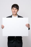 Asian young business man in studio Stock Image