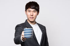 Asian young business man in studio Stock Photo