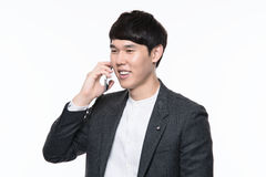 Asian young business man in studio Royalty Free Stock Photos