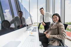 Asian young businessman and businesswoman sitting in front of gr royalty free stock photography