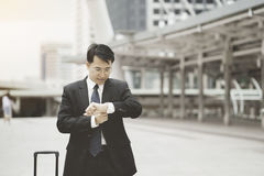 Asian young businessman checking the time Stock Photos