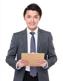 Asian Young businessman hold with clipboard Stock Photos