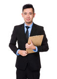 Asian Young Businessman hold with clipboard Stock Images