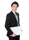 Asian young businessman hold with notebook computer Royalty Free Stock Photography