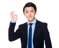 Asian young businessman with ok sign gesture Royalty Free Stock Photography