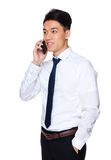 Asian young businessman talk to cellphone Stock Photo