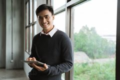 Asian young businessman using tablet pc royalty free stock images