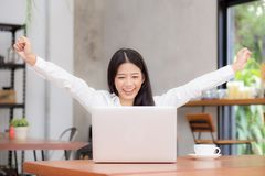 Asian young businesswoman excited and glad of success with laptop. Career freelance business concept stock image