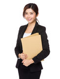 Asian Young businesswoman hold with folder Royalty Free Stock Image