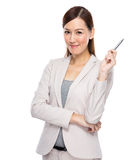 Asian young businesswoman with pen up Royalty Free Stock Photos