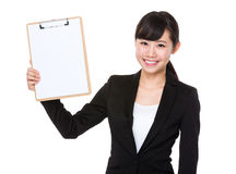 Asian young Businesswoman show with blank page of clipboard. On white background Royalty Free Stock Photos