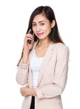 Asian young businesswoman talk to cellphone Royalty Free Stock Photography