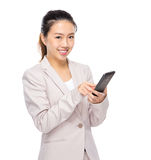 Asian young businesswoman use mobile phone Royalty Free Stock Photos