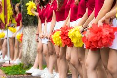 Asian young cheerleader group closeup with legs standing on row royalty free stock photography