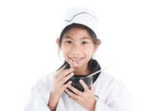 Asian young chef holding rice bowl with sticky rice Stock Photo