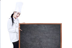 Beautiful chef pointing on copyspace Royalty Free Stock Photos