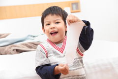 Asian young child wakes up in the morning on the bedroom. Stock Image
