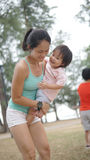 Asian young chinese woman and child in outdoor games Royalty Free Stock Photos