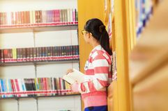 Asian young college student teenager smile with school folders r Stock Photo