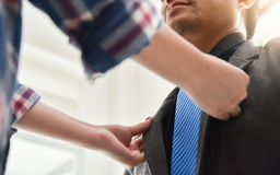 Asian couple getting dressed. Stock Photography