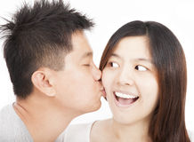 Asian young couple kissing Stock Photography