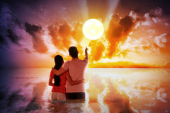 Asian young couple pointing the sun Stock Photography